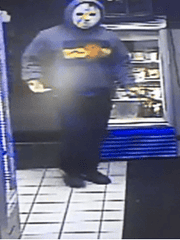 Surveillance cameras captured the image of one suspect in a Friday night attempted robbery of a Dewey Beach convenience store.