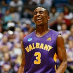 Albany's DJ Evans celebrates an NCAA Tournament victory on Tuesday.
