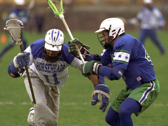 Nate Watkins, left, plays lacrosse for Horseheads against Cicero-North Syracuse in 1998.