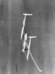 The experimental Voyager aircraft soars toward the
