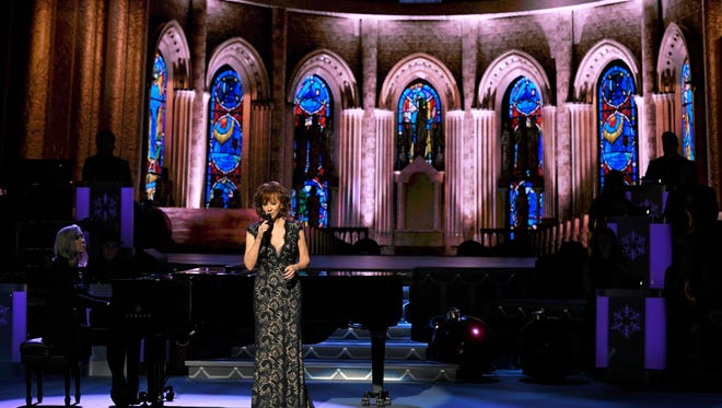 Reba McEntire performs at the CMA Country Christmas show which was taped on Tuesday, Nov. 14, 2017 at the Grand Ole Opry.