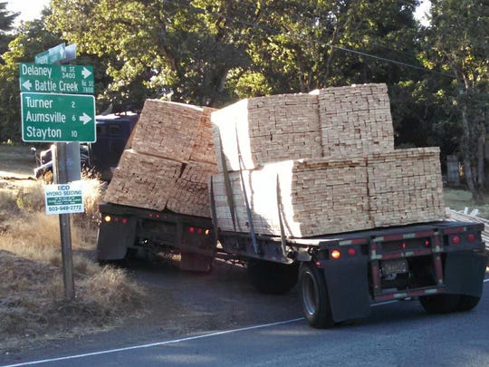 A semi truck carrying a load of lumber crashed on Delany Road SE near Battlecreek Road SE Wednesday morning.