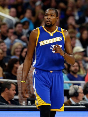 Kevin Durant looks on against the Orlando Magic during the second quarter at Amway Center.