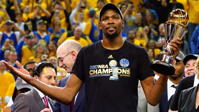 Golden State Warriors forward Kevin Durant (35) celebrates after winning the NBA Fianls MVP in game five of the 2017 NBA Finals at Oracle Arena.