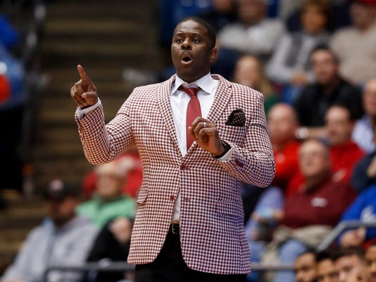 North Carolina Central coach LeVelle Moton talks to his players during the first half of a First Four game of the NCAA men's college basketball tournament, against UC Davis, Wednesday, March 15, 2017, in Dayton, Ohio. (AP Photo/John Minchillo)