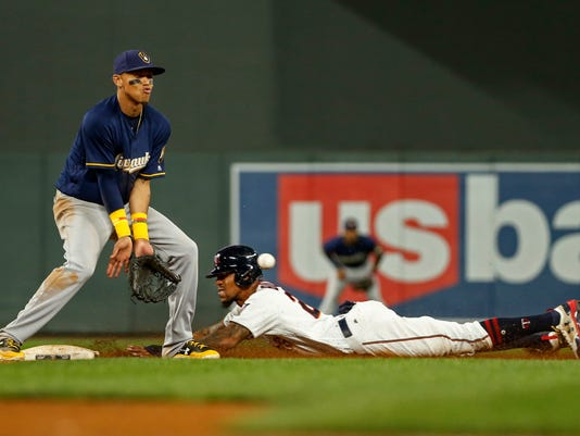 Minnesota Twins Byron Buxton steals second base ahead of the throw to Milwaukee Brewers shortstop Orlando Arcia in the fourth inning of a baseball game, Tuesday, Aug. 8, 2017, in Minneapolis. (AP Photo/Bruce Kluckhohn)