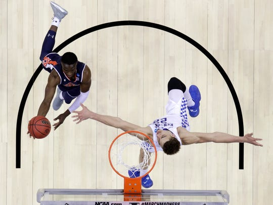 Auburn's Jared Harper drives to the basket against Kentucky's Reid Travis during an NCAA Tournament game on March 31.