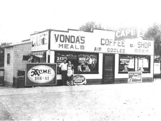 Joe and Vonda Wilson posing in front of Vonda's Cafe