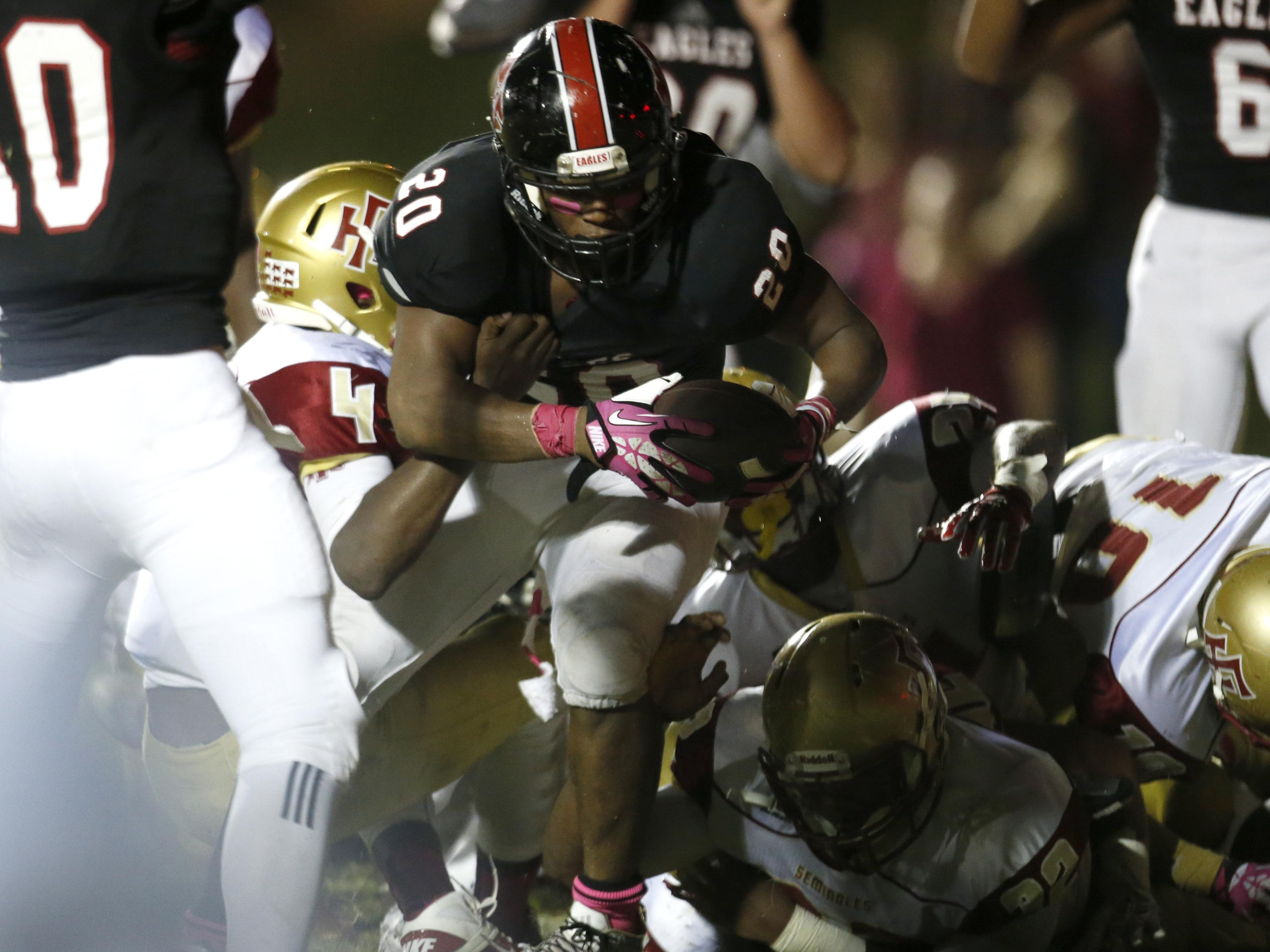 NFC's Jay Harrison breaks the pile for a touchdown against Florida High at NFC on Friday.