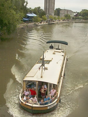 A wine cruise on the Sam Patch packet boat disembarks from Schoen Place in Pittsford.