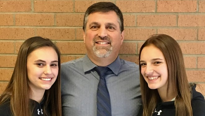 Mike Cordiale and his daughter Mae, left, and niece Peyton Cathey.