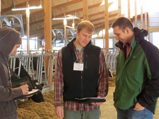 Matt Sharpe of Farm Credit East interacts with students evaluating Ideal Dairy in Hudson Falls, NY.