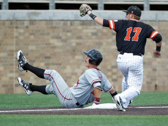 Texas Tech's Josh Jung was called out at third base late in the game by Sam Houston State's Taylor Beene during an NCAA college regional against Sam Houston State.