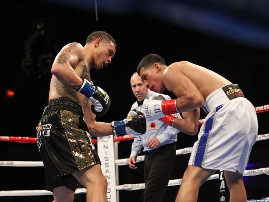 Regis Prograis, left, defeats Joel Diaz Jr. Friday night.