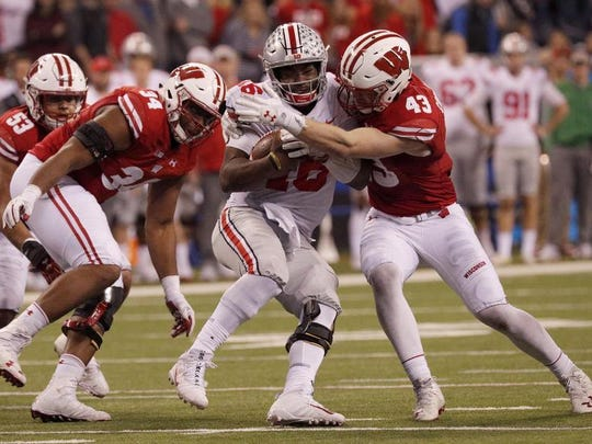 Wisconsin linebacker Ryan Connelly (43) hits Ohio State