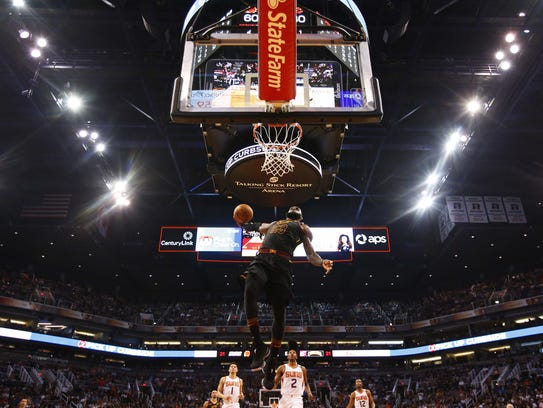 LeBron James rises up for a dunk against the Suns on Tuesday.