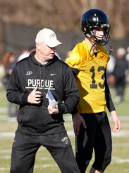 Head coach Jeff Brohm with tips for freshman quarterback