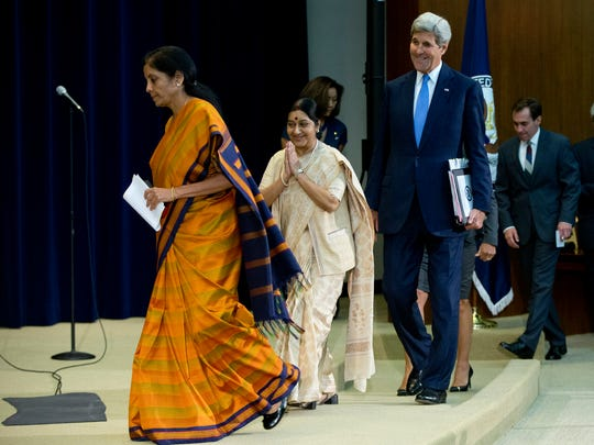 Secretary of State John Kerry, second from right, Indian External Affairs Minister Sushma Swaraj, second from left, and Indian Minister of State for Commerce and Industry Nirmala Sitharaman, left, arrive for a news conference at the State Department in Washington, Tuesday, Sept. 22, 2015.