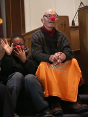 Tay'Von Betts, 10 and Peter Mitchell, of Rochester, smile and laugh to the congregation at Immanuel Baptist Church where they were given clown glasses and a red nose to remember to laugh and smile often on Nov. 13, 2016.
