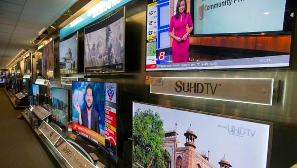Displays of new ultra high definition 4K televisions at HHGregg, an electronics retailer, in Indianapolis, on Nov. 18, 2015. HHGregg thinks the new, improved TVs will be big sellers this holiday season, now that prices have fallen.