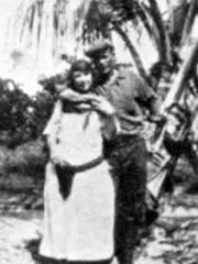 Laura Upthegrove with her .38-caliber revolver and John Ashley in 1921.