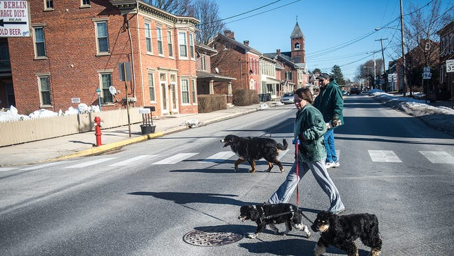 Joanne and Tim Winemiller cross West King Street with their dogs on Feb. 18, 2016 in East Berlin.