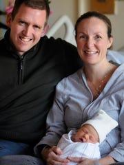 Matthew and Jennie Keane pose with newborn daughter