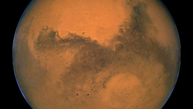 This image released 27 August, 2003 captured by NASA's Hubble Space Telescope shows a close-up of the red planet Mars when it was just 34,648,840 miles away.