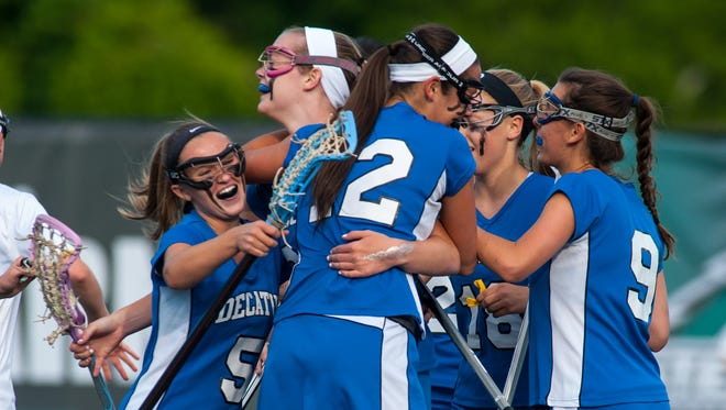The Stephen Decatur girls lacrosse team celebrates after scoring a goal against Century High School in the MPSSAA 3A/2A State Championship at Stevenson University in Owings Mills.