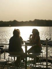 Outdoor diners enjoy the bar area at Rick's Cafe Boatyard on Eagle Creek Reservoir.