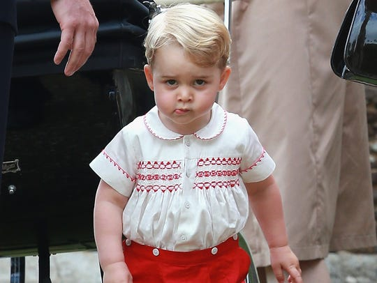 Prince George takes a stand outside St Mary Magdalene Church at Sandringham estate for baby sister Princess Charlotte's christening on July 5, 2015.