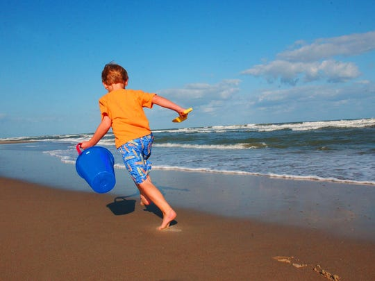 A boy on the beach at Ocracoke on the Outer Banks of North Carolina. The Ocracoke Lifeguarded Beach is No. 4 on the list of best beaches for the summer of 2016.