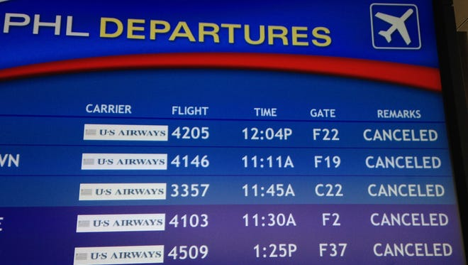 The departure board at the Philadelphia International Airport shows canceled flights on Feb. 3, 2014 after a snowstorm.