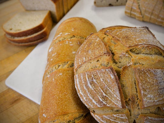 Several different styles of breads made with organic