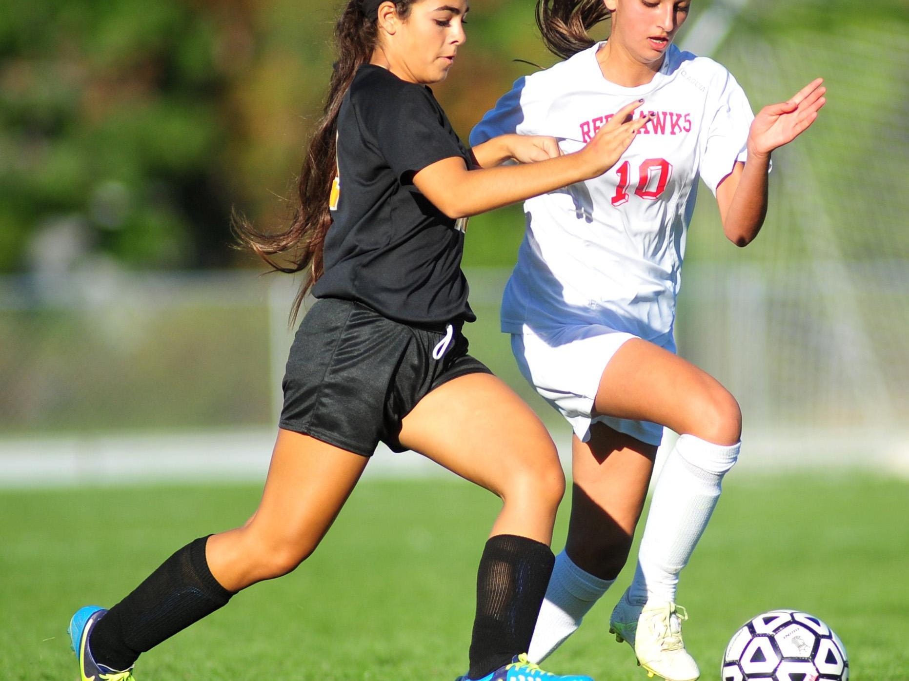 Hanover Park's #19 Haley Scrivo chases the ball with Parsippany's #10 Emilie Rago. Parsippany High School beats Hanover Park 2-0 in girls soccer at Parsippany, NJ. Monday, Oct. 12, 2015. Special to NJ Press Media/Karen Mancinelli/Daily Record MOR 1013 Parsippany-Hanover Park