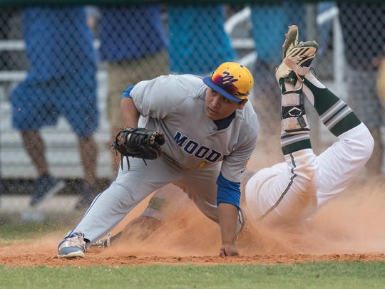 King's Jacob Garza slides in to first base safe as
