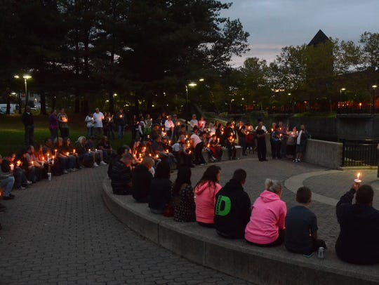 About 100 people held candles in Battle Creek's Friendship