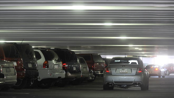 A motorist drives slowly in a lane in the parking garage on LaPorte Ave. and Mason Street, looking for a parking spot in Old Town in this file photo.