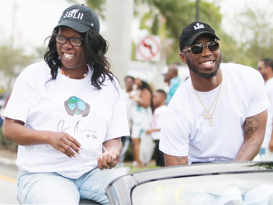 Brandy Peterson and her son Jaylen Watkins celebrate Easter recently during the annual Dunbar Easter Parade in Fort Myers. Watkins won the Super Bowl in January while playing with the Philadelphia Eagles. He now plays for the Los Angeles Chargers. More than 1,000 people enjoyed floats, live music and dance performances. Local churches, radio personalities and city officials also took part in the event along Dr. Martin Luther King Jr. Boulevard.