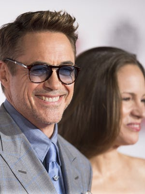 """Robert Downey Jr.  and his wife, Susan Downey,  are all smiles at the """"Avengers"""" premiere."""