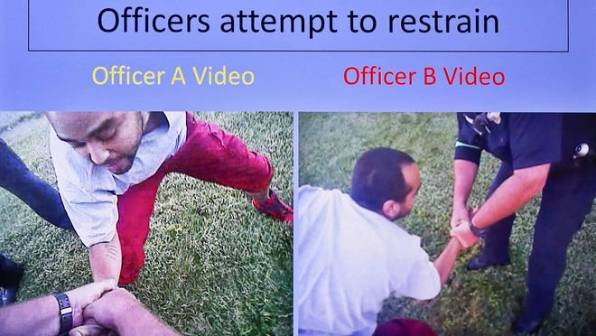 This image from Topeka police body camera video shows officers struggling with Dominique White, who had a handgun in his pocket, before he broke free, started to run away and was fatally shot in September 2017.