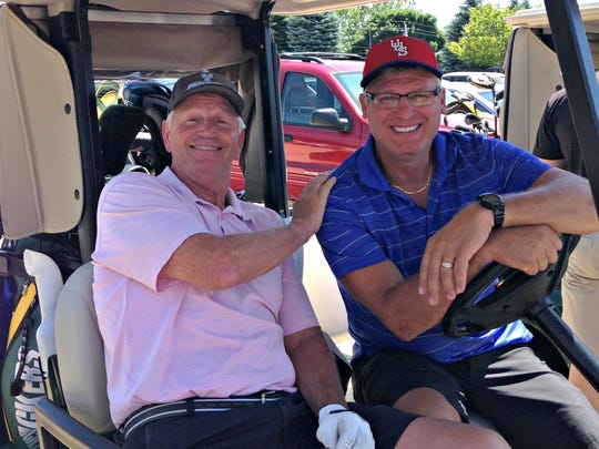 Mike Exline and Urbandale Superintendent Steve Bass pose together for a photo during the third annual Brad Peyton Memorial Golf Tournament June 27 in Urbandale.