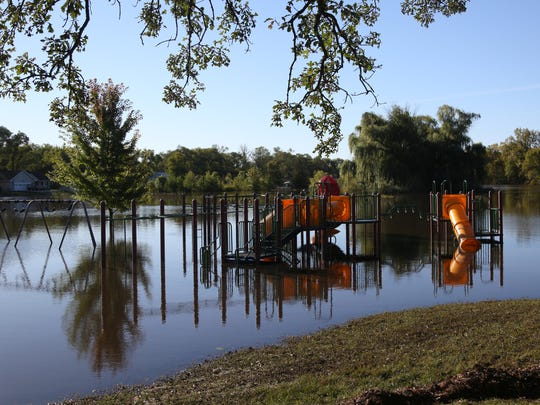 Floodwaters surround the playground of North Cedar