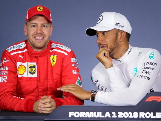 FILE - In this Saturday, March 24, 2018 file photo, Mercedes driver Lewis Hamilton, right, of Britain, and Ferrari driver Sebastian Vettel of Germany laugh during a press conference following qualifying at the Australian Formula One Grand Prix in Melbourne. Mercedes blames a bug from an offline tool for the timing error which hindered Formula One champion Lewis Hamilton's bid to win the Australian Grand Prix. (AP Photo/Asanka Brendon Ratnayake, File)