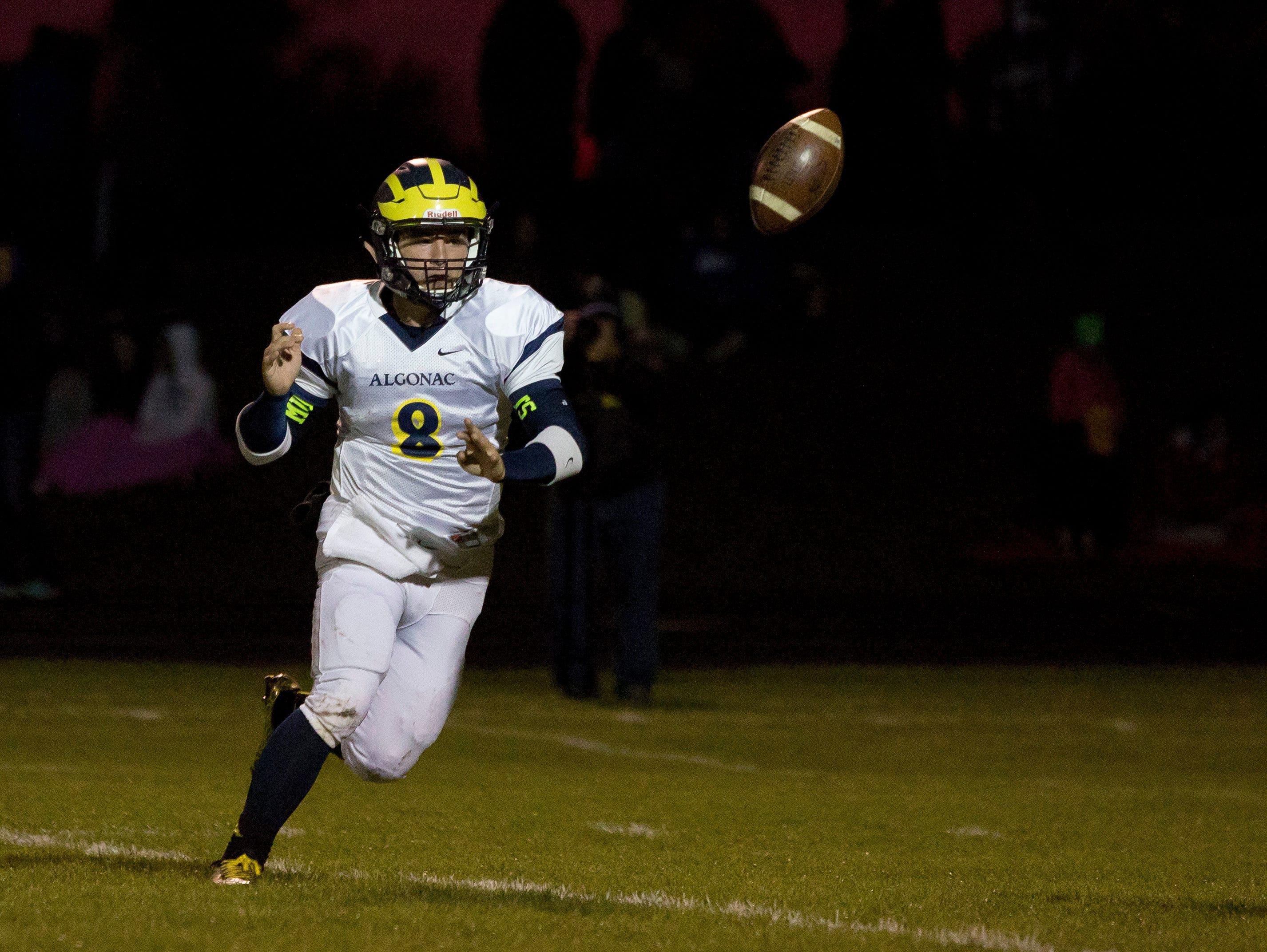 Algonac's AJ Garshott tosses the ball during a football game Friday, October 2, 2015 at Croswell-Lexington High School.