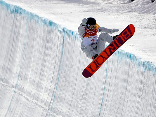 Kelly Clark, of the United States, jumps during the women's halfpipe qualifying at Phoenix Snow Park at the 2018 Winter Olympics in Pyeongchang, South Korea, Monday, Feb. 12, 2018. (AP Photo/Gregory Bull)