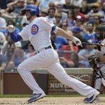 Cubs third baseman Kris Bryant hits a single against the Marlins on Sunday in Chicago.
