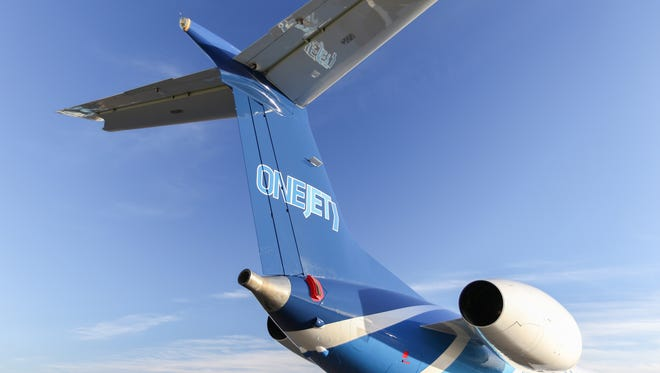 This image, provided by OneJet, shows and Embraer regional jet in the company's color.