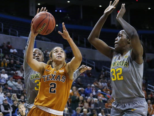 Texas guard Celina Rodrigo (2) shoots between Baylor guard Alexis Jones, left, and forward Beatrice Mompremier (32) in the second quarter of an NCAA college basketball championship game in the Big 12 women's tournament in Oklahoma City, Monday, March 7, 2016. (AP Photo/Sue Ogrocki)