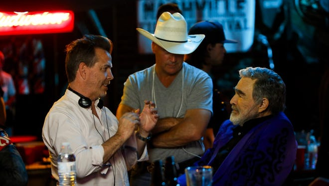 "From left, producers Neil Mandt and Gordon Whitener and actor Burt Reynolds working on the Knoxville-filmed ""Dog Years."""